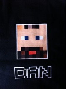 An 8 bit representation of me on the presenter t-shirt. Designed by @fabsh