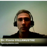 A screenshot from the show of Flavio with headset on talking to the camera